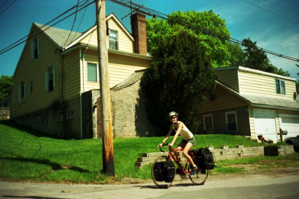 Me riding my bike around the block exactly one time prior to setting out across the country. 238 Brady in the background.