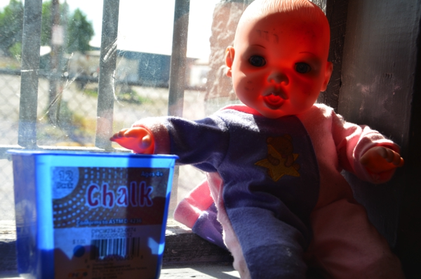 Creepy doll in the Lewis & Clark brewery. Note the bars on the window from the old jail.