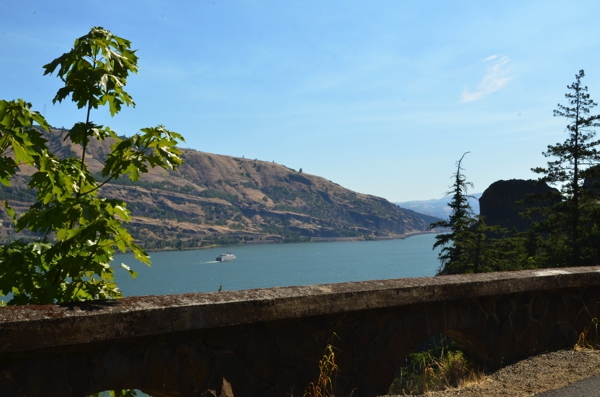 A view of the Columbia River with a section of the original barrier wall on the restored trail