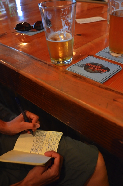 Sarah catching up on her writing at Seaside Brewing