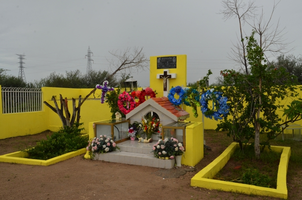 An elaborate roadside memorial, decorated for Día de Muertos
