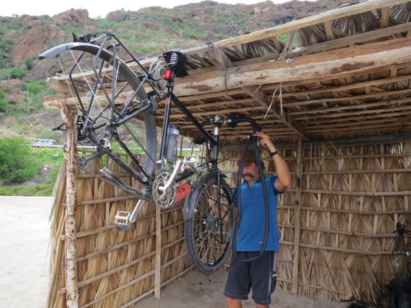 Palapa bike maintenance.  Scott woke to TWO flat tires.