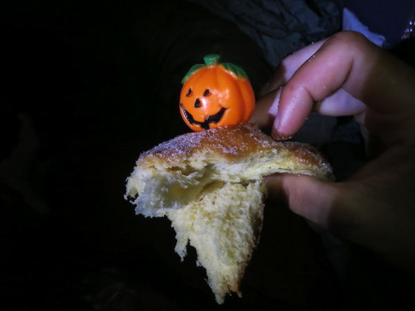 A pumpkin on top of the pan de muerto