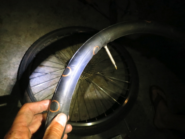 Late night puncture repair.  Sarah's tire is slowly becoming more patch than tube