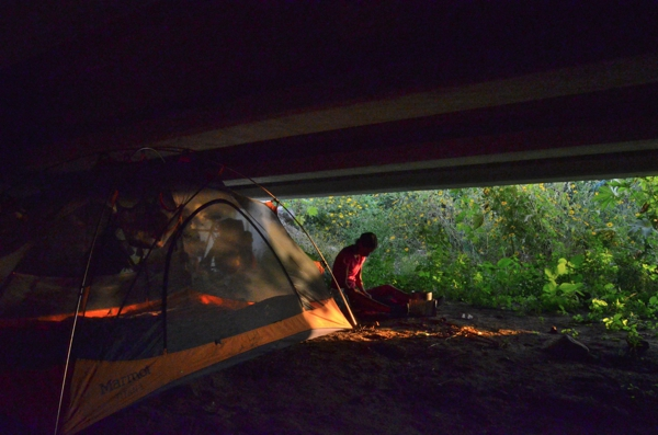 Homeless, living under a bridge …