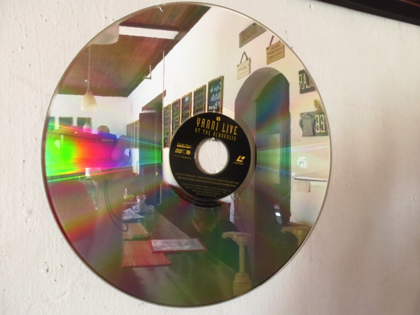 A LaserDisc on the wall of our favorite coffee shop.  The  marketing department  of MCA decided to market them as DiscoVision as disco was on it's way out.