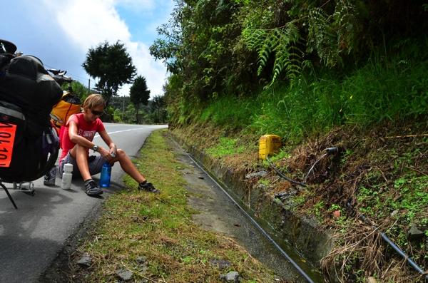 Sarah gathering spring water