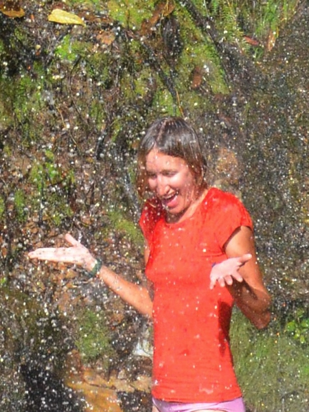 refreshing rinse in the waterfall