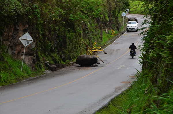 Debris in the road (rocks or mudslides) or half a lane missing due to a washout is not uncommon in this part of the country