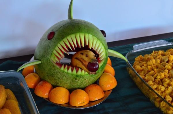 Lunch fruit sculpture: A watermelon shark eating a banana dolphin.