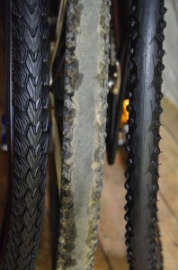From left to right, new Schwalbe Marathon Plus Tour tire, well used Continental TravelContact and new Conti TravelContact.  Stay tuned for the Conti vs. Schwalbe touring tire shootout …