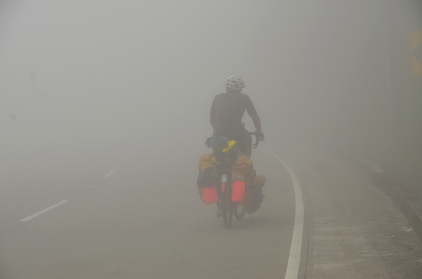 Cyclists in the mist.