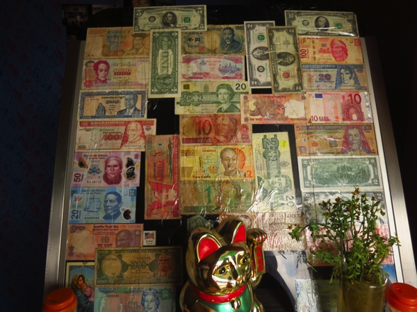 Manny's collection of currency from around the world, including a 1953 US $2 bill