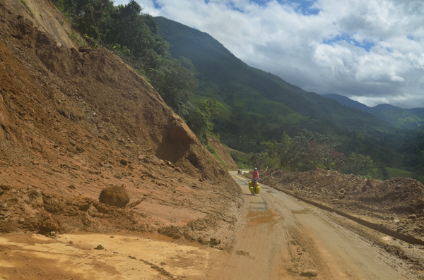 Landslide partially covering the road