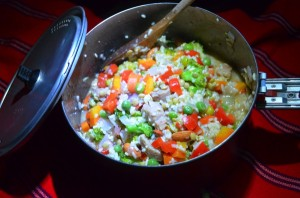 We cook up a rice and vegetable dish with the veggies we found at the Cajamarca market.
