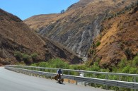Scott riding next to the most impressive guardrail we've seen in Peru. (and only guardrail we've encountered)  Comical that it's only about a 20 foot drop to the river, but when there's over a 1000 foot drop they don't bother.