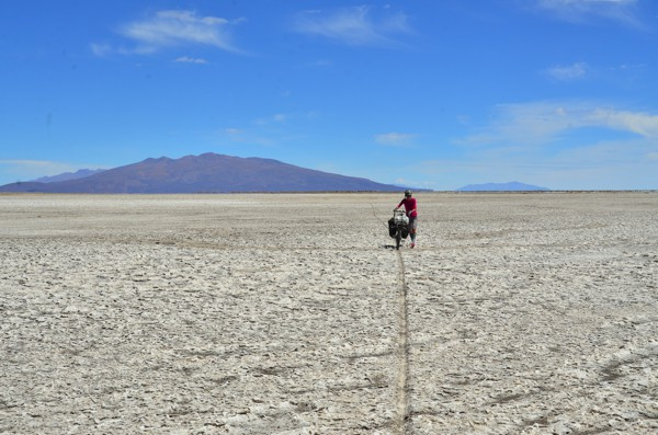 Pushing. The salar surface was so sticky it was faster and easier to walk the bikes.