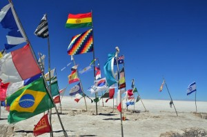 flags from around the world  stuck into the salar