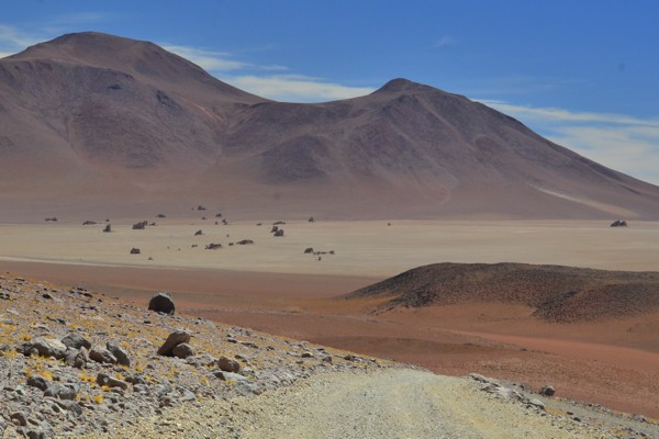 In the distance: volcanic rock formations in the Dali Desert