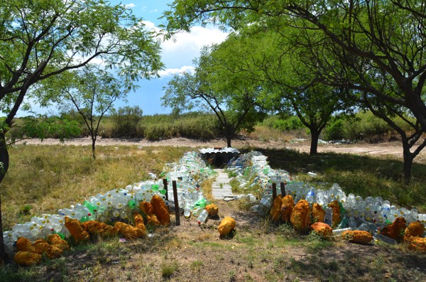 An altar to Difunta Correa. The hundreds of bottles filled with water are to quench her her eternal thirst.