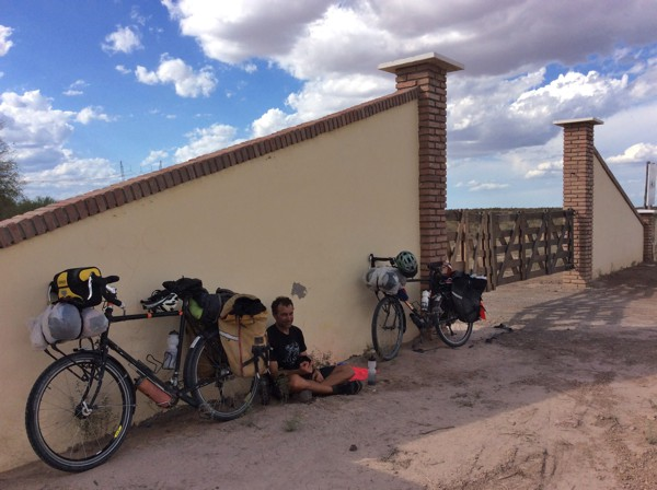 We sat against the entrance gate to this ranch because it provided a bit of shade from the brutal sun.