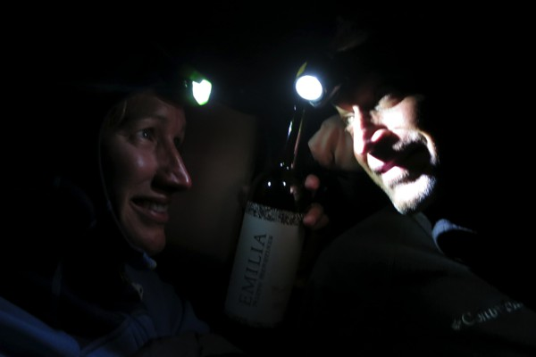 Enjoying a good Argentine wine by the light of our headlamps.