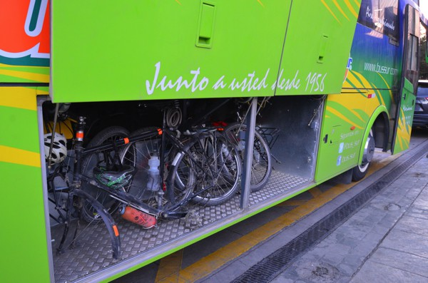The bikes were loaded in the luggage compartment of the bus. The wheels had to be removed to fit. The bike incurred more accidental damage traveling from Ushuaia to Santiago in the two buses than the 20,000 miles on the road.