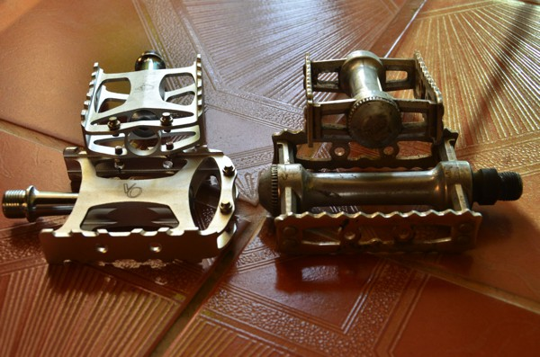 new Velo Orange pedals next to an worn pair of MKS Sylvan Touring pedals