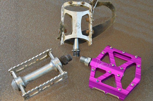 kaleidoscope of pedals (clockwise from top - VO Touring with worn Power Grip straps, new VP Components VP-001, MKS Sylvan Touring