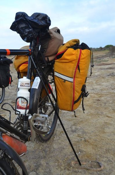 Click-Stand kickstand in use in the sand with a little help from some jetsam