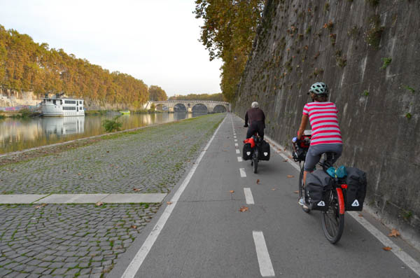 Riding along the Tiber River into Rome.